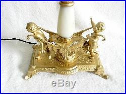 Large art nouveau slag glass shade table lamp with cheub base