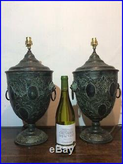 Pair Of Large Urn Shaped Lamps With Lions Head Handles In Vere De Gris Metal